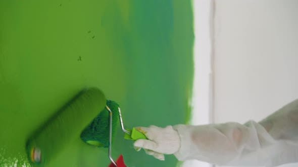Thumbnail for Builders in Protective Suits Paint Wall Green Closeup
