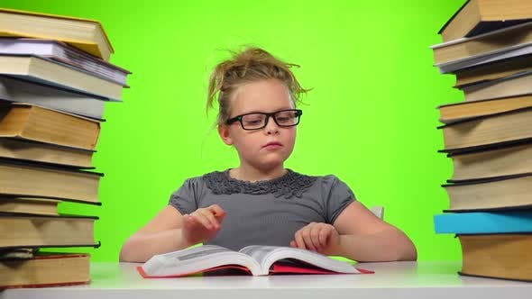 Thumbnail for Girl Leafing Through the Pages of Books Carefully. Green Screen. Slow Motion