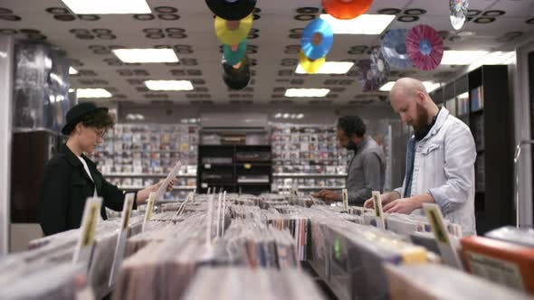 Cover Image for Stylish Caucasian Woman Choosing Vinyls in Music Shop