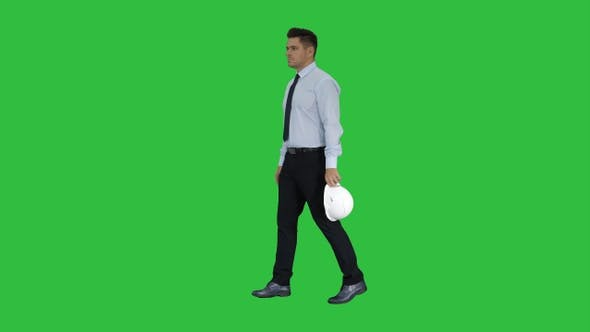 Thumbnail for Businessman putting hardhat helmet on Safety on a Green