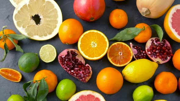 Thumbnail for Close Up of Citrus Fruits on Stone Table