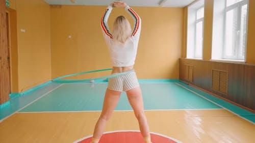 A Woman is Rotating Hula Hoop