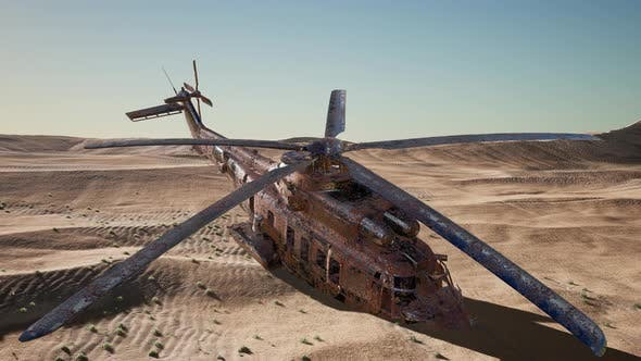 Cover Image for Old Rusted Military Helicopter in the Desert at Sunset