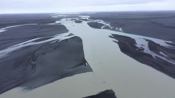 Flying Over a Glacial River System in Iceland, Aerial View