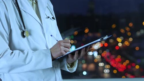 Doctor Writing Prescription And Traffic On Road