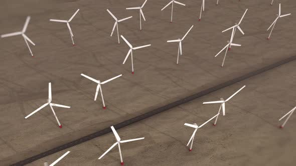 Thumbnail for Windmills with rotating blades on a field