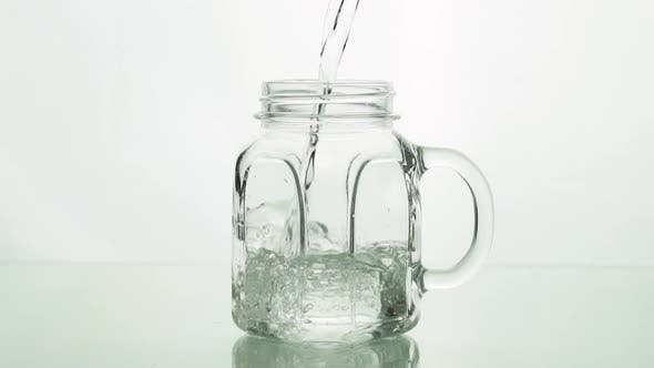 Thumbnail for Сrystal Clear Water Pouring Into Glass Jar Shaped Mug