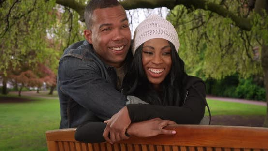 Thumbnail for Laughing black male and female enjoy a nice day at the park