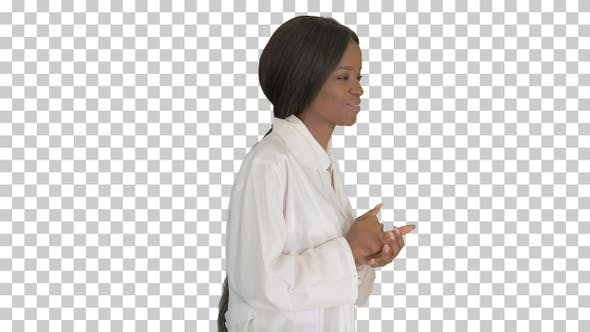 Young african american female doctor talking, Alpha Channel