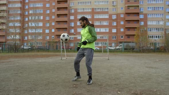 Thumbnail for Middle Eastern Sportsman Juggling Soccer Ball on Outdoor Field