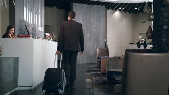 Thumbnail for Businessman with Travel Suitcase Arriving in Hotel at Holiday