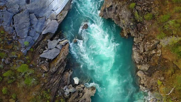 Thumbnail for Fly above the surface of a mountain river Glomaga,Marmorslottet , Mo i Rana,Norway