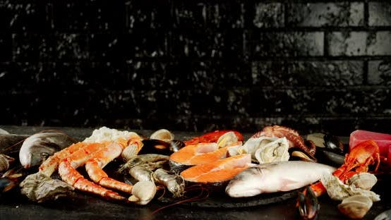Thumbnail for Fish and Seafood Rotate on a Stone Board