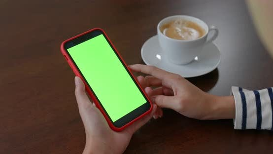 Thumbnail for Woman use of mobile phone with green screen
