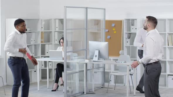 Thumbnail for Coworkers Enjoying Active Break in Office