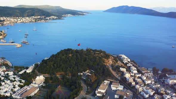 Thumbnail for Aerial Shot Orbiting Around Hill with Red Turkish Flag on Top
