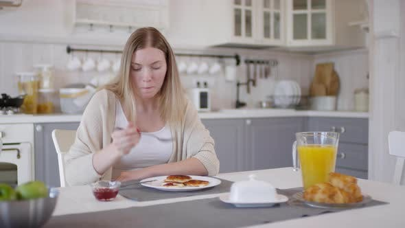 Thumbnail for Woman Eating Pancakes in Morning