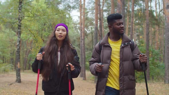 Multiracial Couple Choosing Direction for Hiking