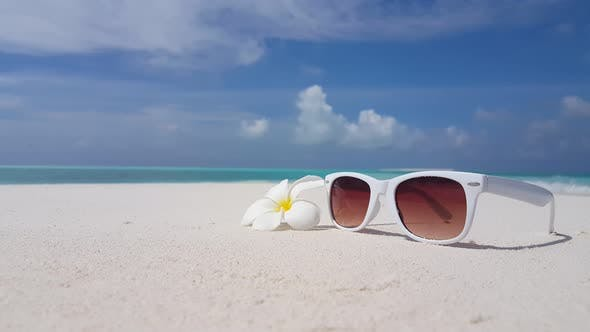 Wide overhead copy space shot of a sunshine white sandy paradise beach and aqua turquoise water back