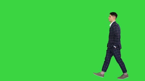 Young Cool Elegant Man Walking By on a Green Screen, Chroma Key