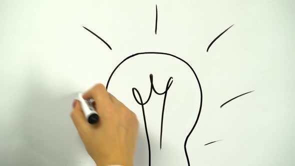 Thumbnail for Drawing of a Light Bulb As a Symbol of an Idea Drawn on a Board