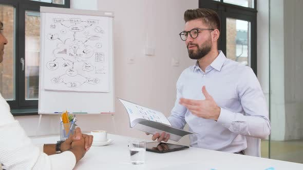 Employer Having Interview with Employee at Office