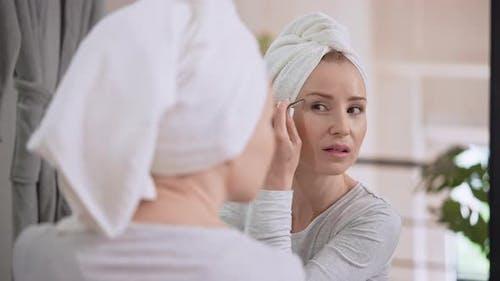 Caucasian Adult Woman Plucking Eyebrows