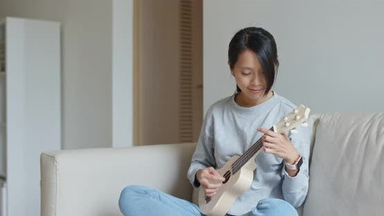 Thumbnail for Woman play with ukulele