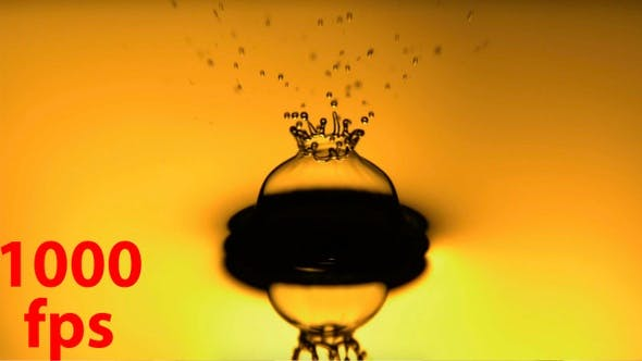 Oil Drop Falling In Slow Motion With Yellow Backlit Background