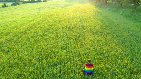 Thumbnail for Flying Over Lesbian Gay Woman Holding Rainbow Flag in the Outdoors