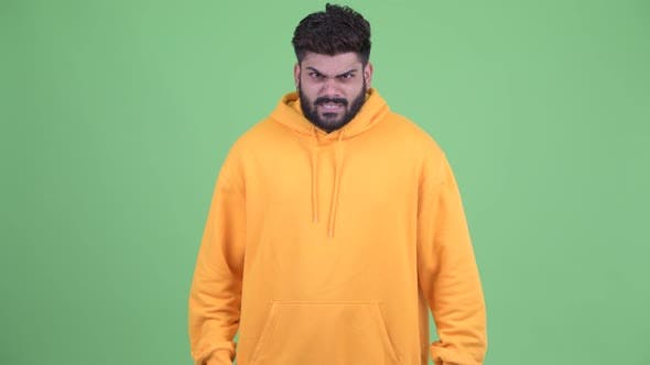 Angry Young Overweight Bearded Indian Man Shouting and Screaming