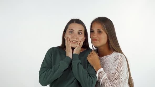 Thumbnail for Female Friends Looking Away, Laughing Looking Surprised