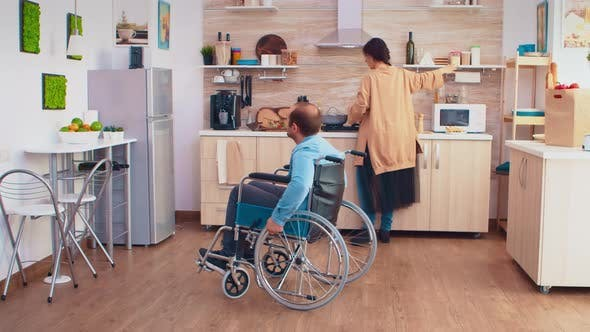 Disabled Man in Wheelchair Opens Refrigerator