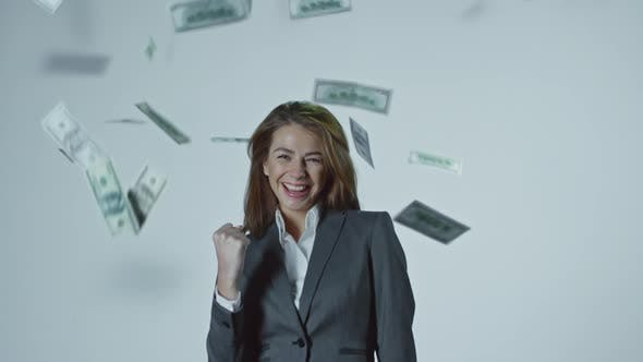 Thumbnail for Dollars Falling on Successful Young Businesswoman