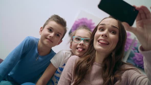Thumbnail for Happy Family Taking Mobile Selfie