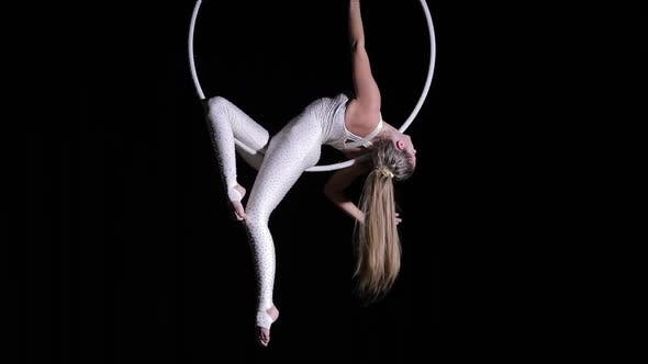 Thumbnail for Woman Circus Performer Make Trick on a Dark Stage