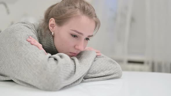 Thumbnail for Unhappy Young Woman Resting on Table and Thinking
