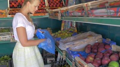 Choosing fruit in market