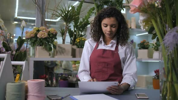 Cover Image for Florist Taking Orders Using Tablet in Flower Shop