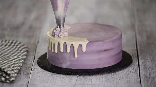 Thumbnail for Chef Decorating Cake with a cream.
