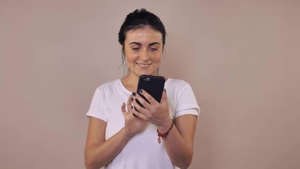 Brunette Using Mobile Phone