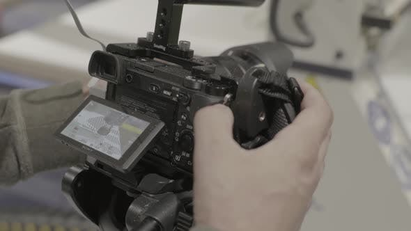 Thumbnail for Close-up of a DSLR Camera in the Hands of a Cameraman Photographer While Shooting a Video Photo