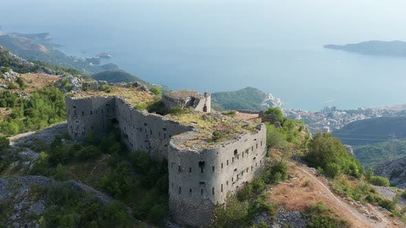 Thumbnail for Ruin of an old stone fortress on the top of the hill, overlooking the coast and sea