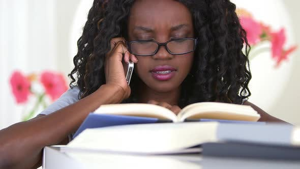Thumbnail for Black teenager calling a friend for homework help