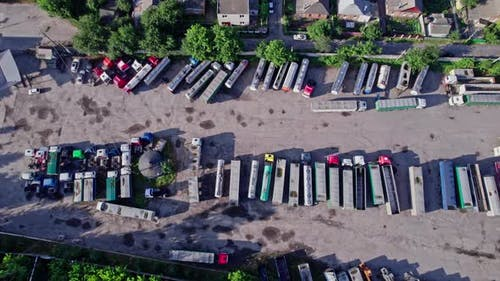 Semi Trucks Loading Cargo Containers