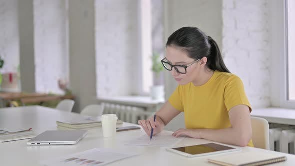 Thumbnail for Ambitious Young Female Designer Writing on Papers in Office