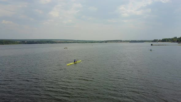 Athletes Training on Kayaks