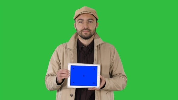 Cover Image for Man walking and holding tablet with blue screen mockup