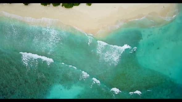 Thumbnail for Aerial view scenery of beautiful coastline beach lifestyle by aqua blue ocean with white sandy backg