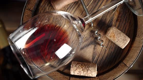 On the Barrel Is a Glass of Red Wine. Slowly Rotating